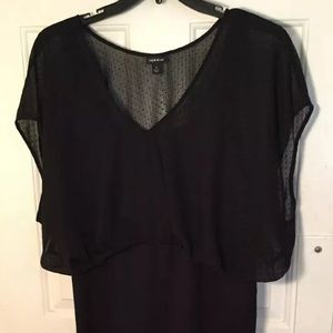 Solid black dress. Short length and sleeves. Sheer